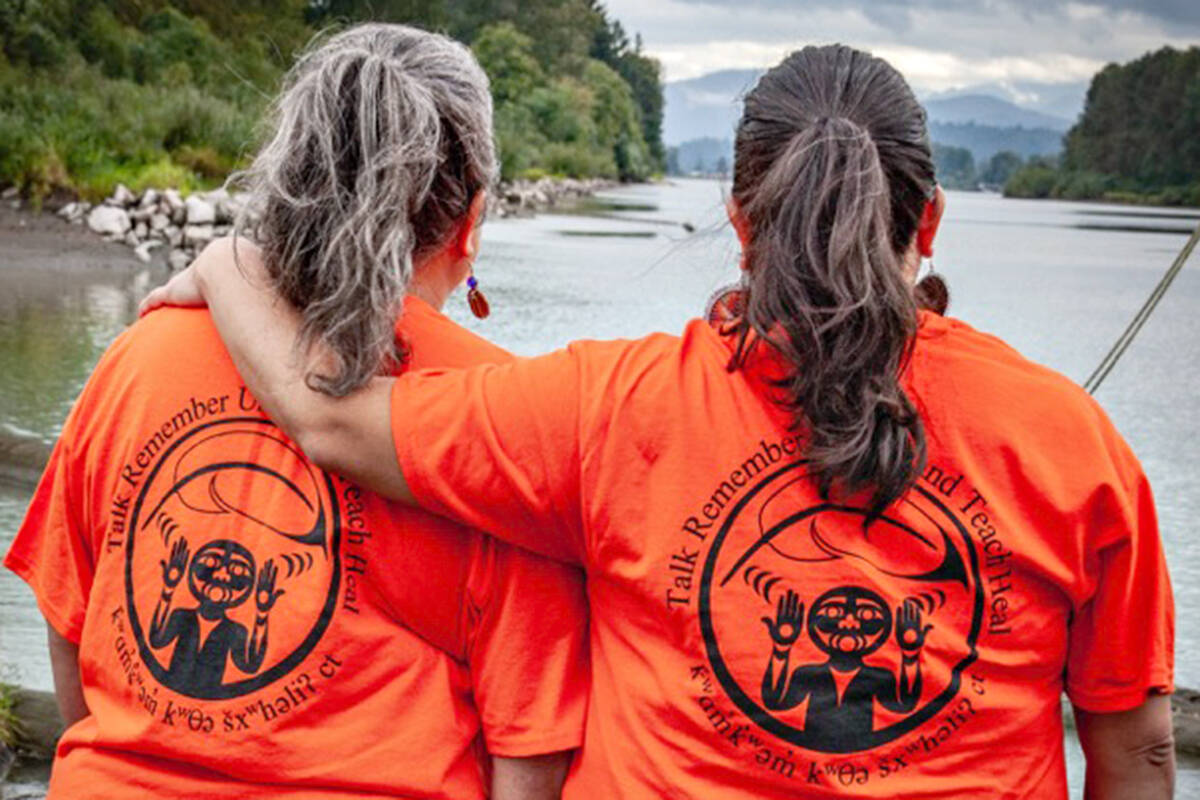 Fern Gabriel (left) and Phyllis Atkins of the Kwantlen First Nation model orange shirts for Truth and Reconciliation Day bearing the motto T.R.U.T.H. – Talk, Remember, Understand, Teach, Heal. More than 300 were made, and they were almost completely sold out in a week. (Byron Smith/Special to Langley Advance Times)