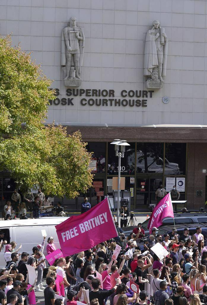 Britney Spears supporters demonstrate outside the Stanley Mosk Courthouse, Wednesday, Sept. 29, 2021, in Los Angeles. A Los Angeles judge will hear arguments at a hearing Wednesday over removing Spears' father from the conservatorship that controls her life and money and whether the legal arrangement should be ended altogether. (AP Photo/Chris Pizzello)