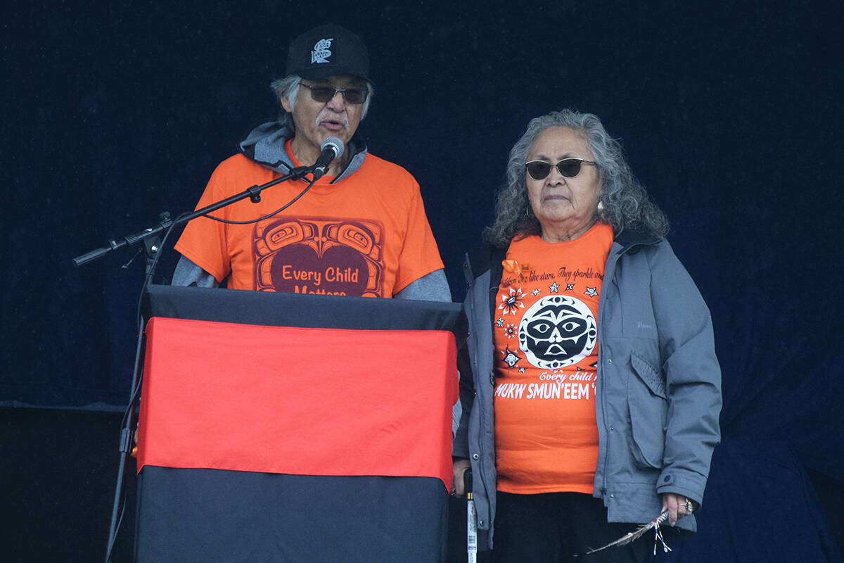 Wally Samuel of Ahousaht First Nation, accompanied by his wife Donna, speaks about his experience going to school at Tsuma-as. (ELENA RARDON / ALBERNI VALLEY NEWS)