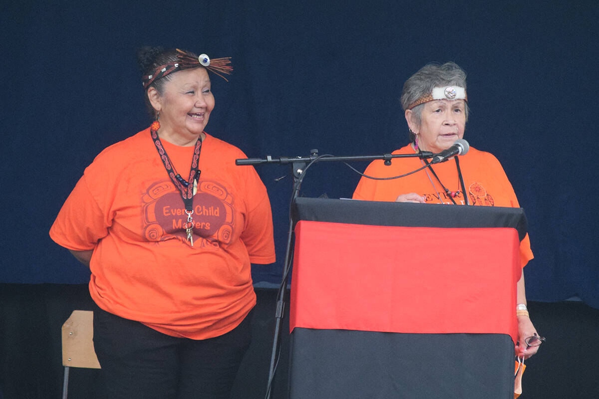 Left to right, Nuu-chah-nulth education workers Peggy Tatoosh and Jean Thomas lead the unveiling ceremony for Tsuma-as Elementary School on Sept. 29. (ELENA RARDON / ALBERNI VALLEY NEWS)