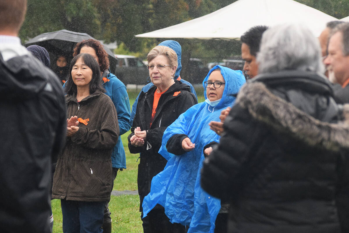 Several School District 70 representatives, including board chair Pam Craig, joined Tseshaht First Nation on Sept. 29 for a song prior to the unveiling of a new name for Tsuma-as Elementary School. (ELENA RARDON / ALBERNI VALLEY NEWS)