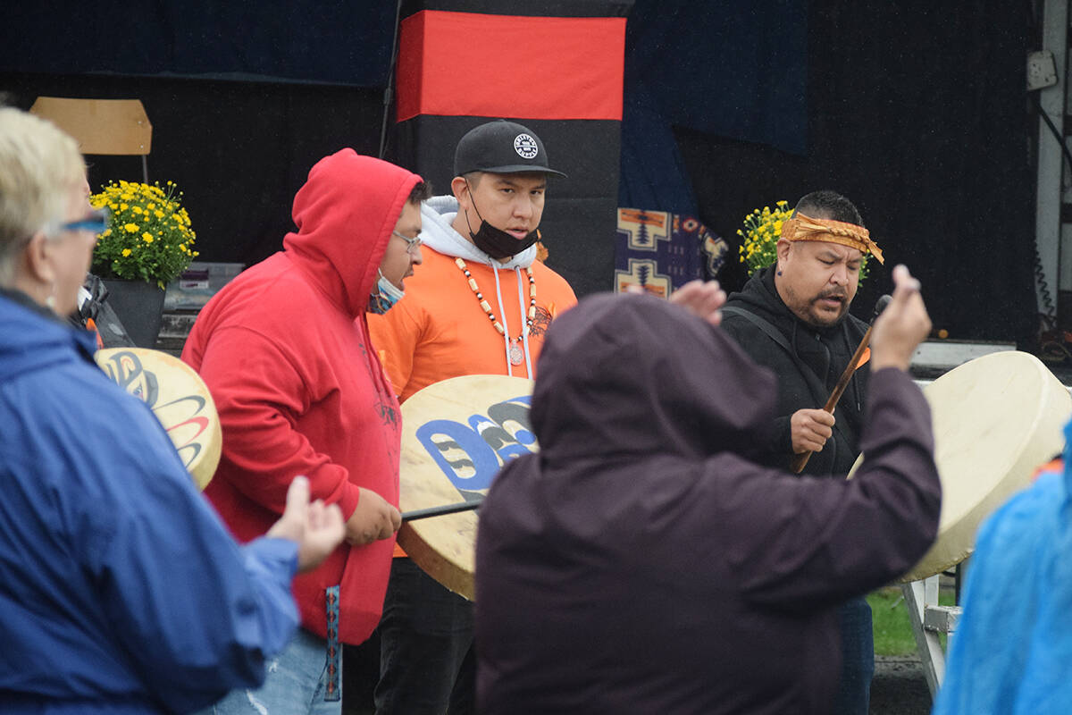 Members of Tseshaht First Nation are joined by School District 70 representatives for a song before the unveiling of Tsuma-as Elementary School's new name on Sept. 29. (ELENA RARDON / ALBERNI VALLEY NEWS)