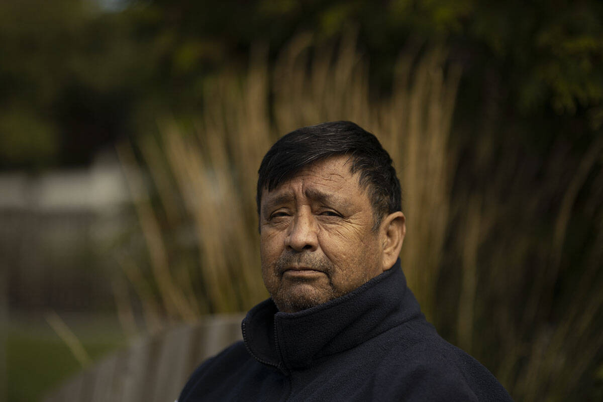 Nanaimo Indian Hospital survivor Melven <ins>(Sx̄wen)</ins> Jones recounts the abuse he endured at six years old, as he sits outside his home in Victoria. (Arnold Lim/Black Press Media)