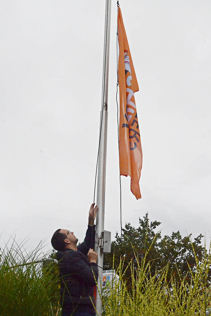 Centre executive director Anthony Kupferschmidt raised a reconciliation flag to half mast. (Matthew Claxton/Langley Advance Times)