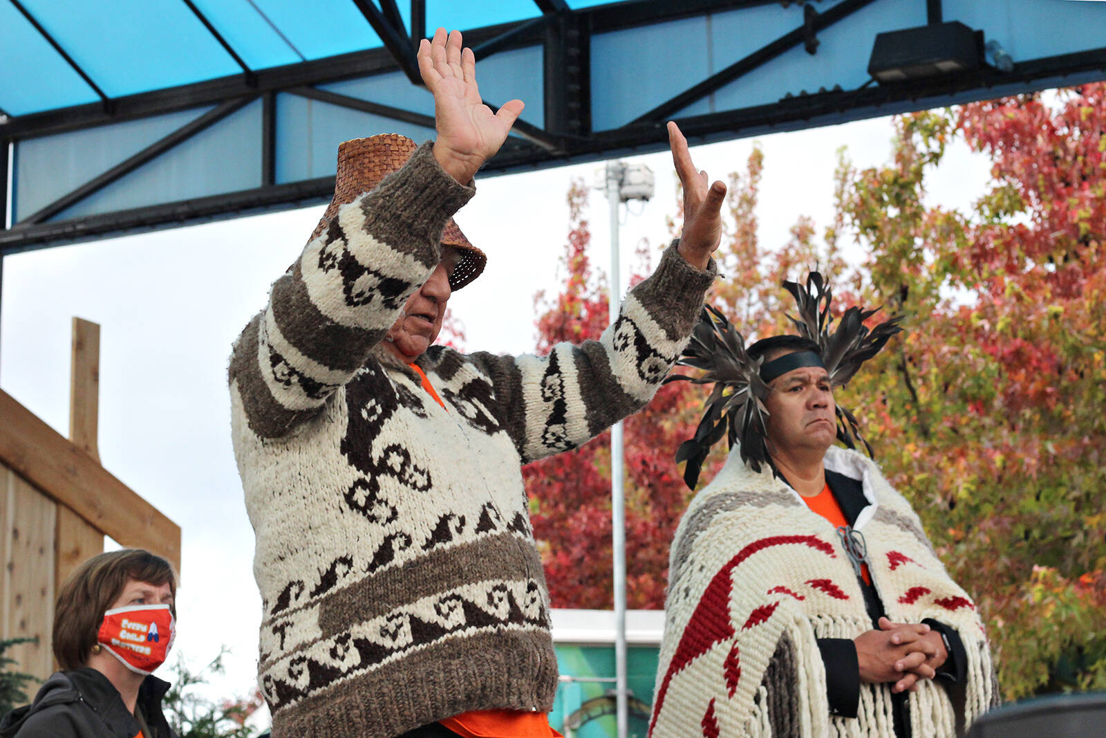 Snuneymuxw Elder Gary Manson, front, with Nanaimo MLA Sheila Malcolmson and Snuneymuxw Chief Mike Wyse looking on, asks people to turn toward the sea before he says a closing prayer Thursday, Sept. 30, at a National Day for Truth and Reconciliation event at Maffeo Sutton Park. (Greg Sakaki/News Bulletin)