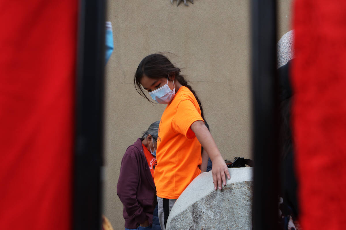 A child is pictured from outside of the Ki-Low-Na Friendship Society on Sept. 29 during the group's ceremony that honoured the inaugural National Day for Truth and Reconciliation on Sept. 30. (Aaron Hemens/Capital News)