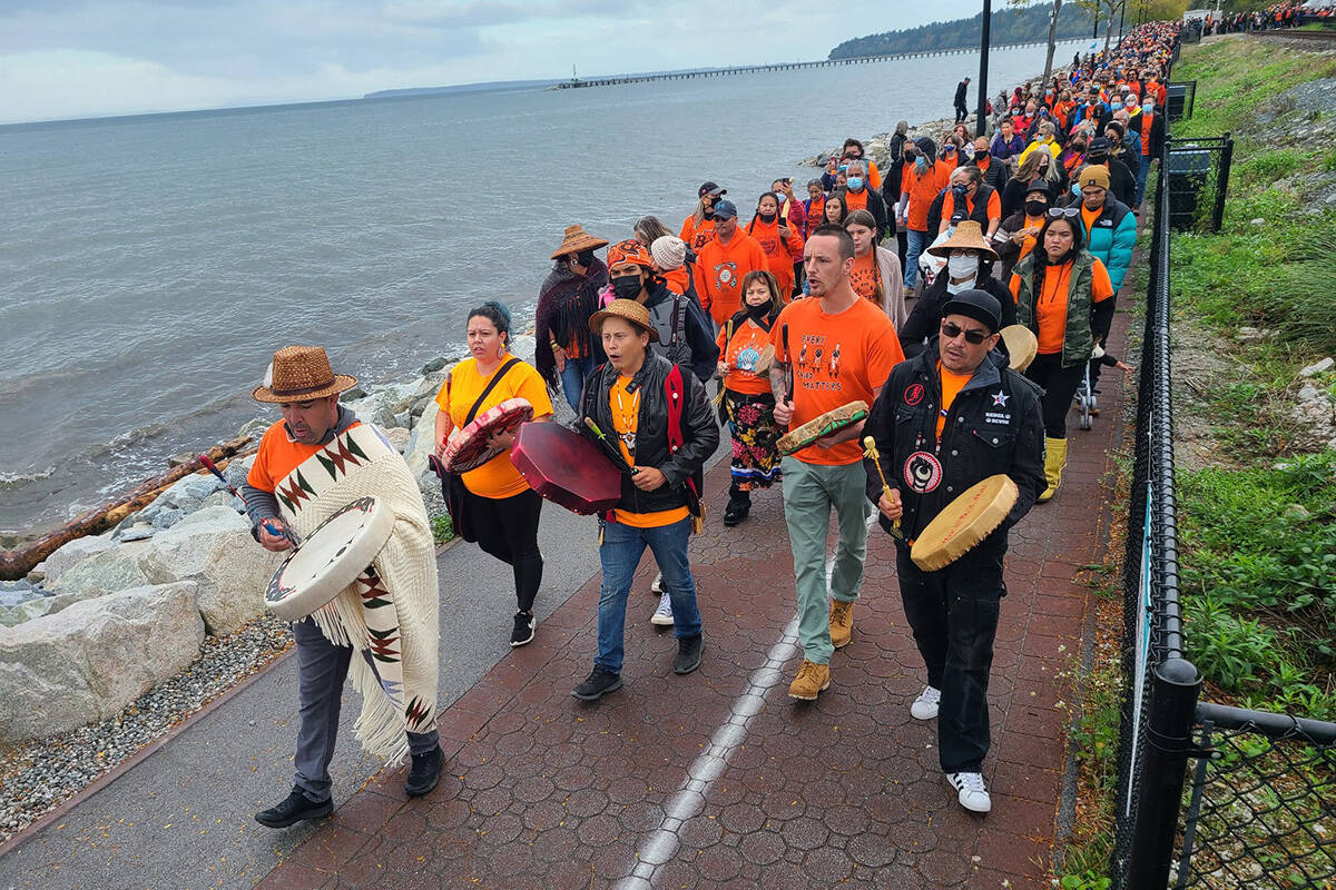 Semiahmoo First Nation Chief Harley Chappell leads walkers along the waterfront promenade between Grand Chief Bernard Charles Memorial Plaza and Semiahmoo Park on Thursday, Sept. 1. Thousands of people attended the Walk for Reconciliation hosted by the SFN. (Aaron Hinks/Peace Arch News)