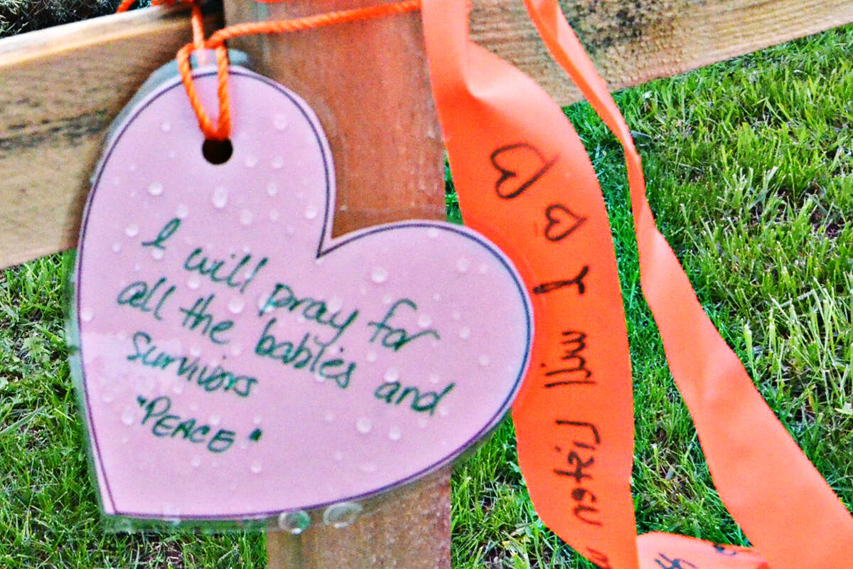 People wrote messages on laminated hearts that were attached to wooden crosses at the Derek Doubleday Arboretum. (Heather Colpitts/Langley Advance Times)