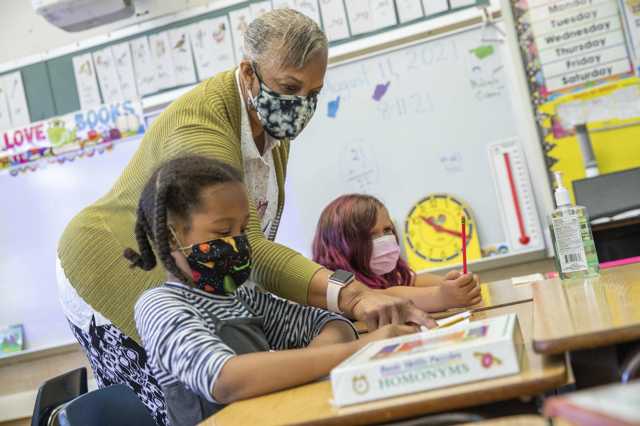 Teacher Joy Harrison instructs her second graders as California Gov. Gavin Newsom visits the classroom at Carl B. Munck Elementary School, Wednesday, Aug. 11, 2021, in Oakland, Calif. Gov. (Santiago Mejia/San Francisco Chronicle via AP, Pool)
