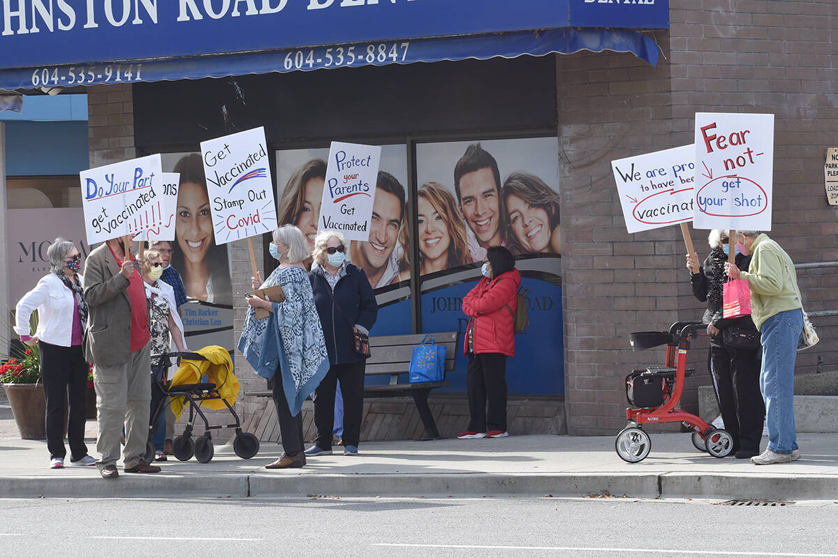 A group of about a dozen Semiahmoo Peninsula seniors rallied in support of COVID-19 vaccinations Friday afternoon in White Rock. (Nick Greenizan photo)