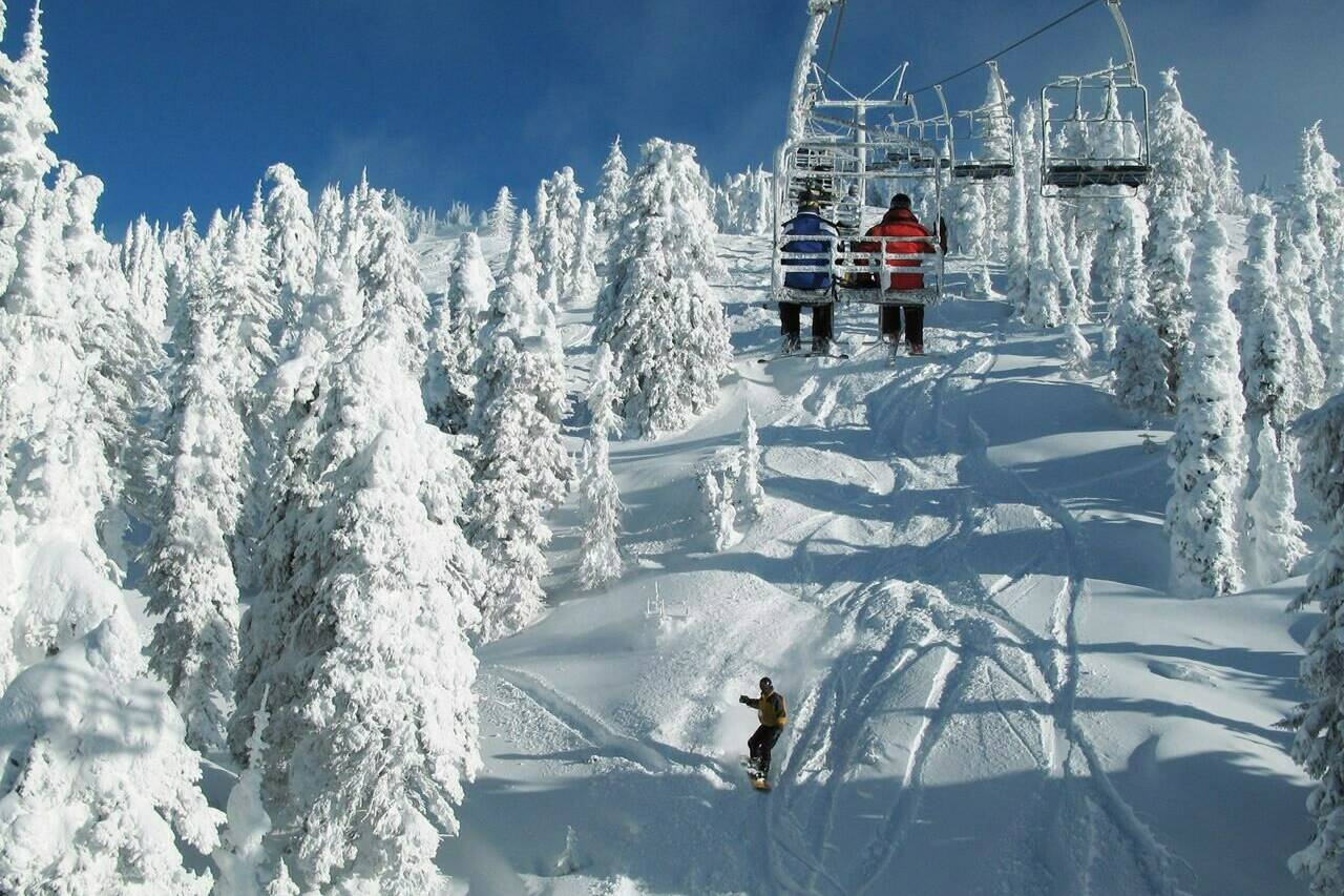 A snowboarder glides under a chairlift at the Big White Ski Resort, Wednesday, Jan. 30, 2008 near Kelowna, B.C. Strength in season pass sales has been one bright spot in an otherwise difficult year for big mountain resorts in Western Canada. THE CANADIAN PRESS/Jacques Boissinot