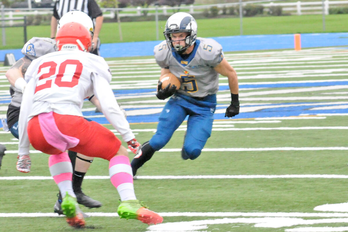 Joel Klaassen carried the ball as Langley Rams won their fourth in a row of the season on Saturday, Oct. 2, downing the Westshore Rebels 37-7 at home. (Dan Ferguson/Langley Advance Times)