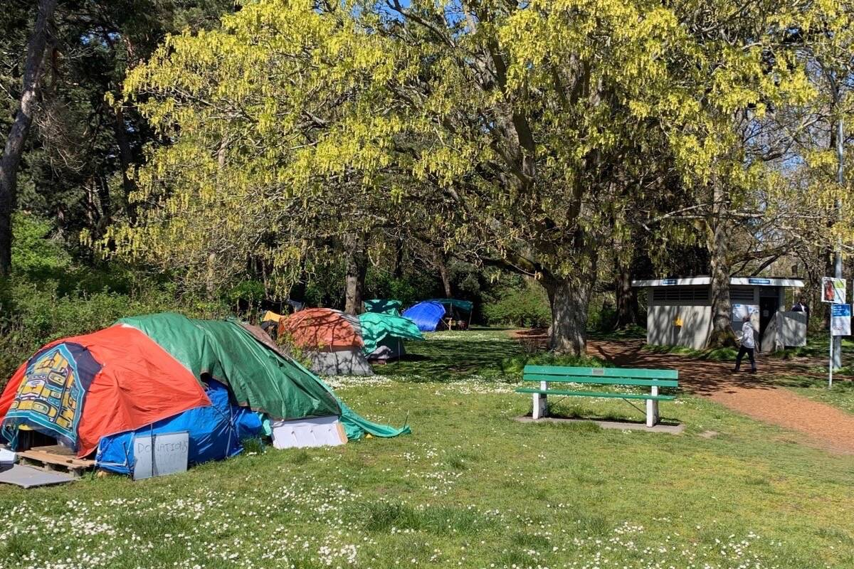 Tent camp at Beacon Hill Park in Victoria, April 2021. B.C. communities are struggling with COVID-19 infection among people living in tents or on the street. (Tom Fletcher/Black Press)