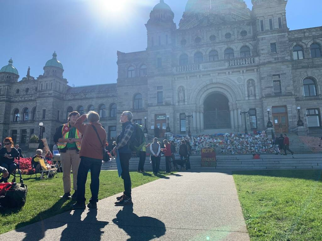Protesters gathered outside the B.C. legislature to demand action against old-growth logging. (Kiernan Green/News Staff)