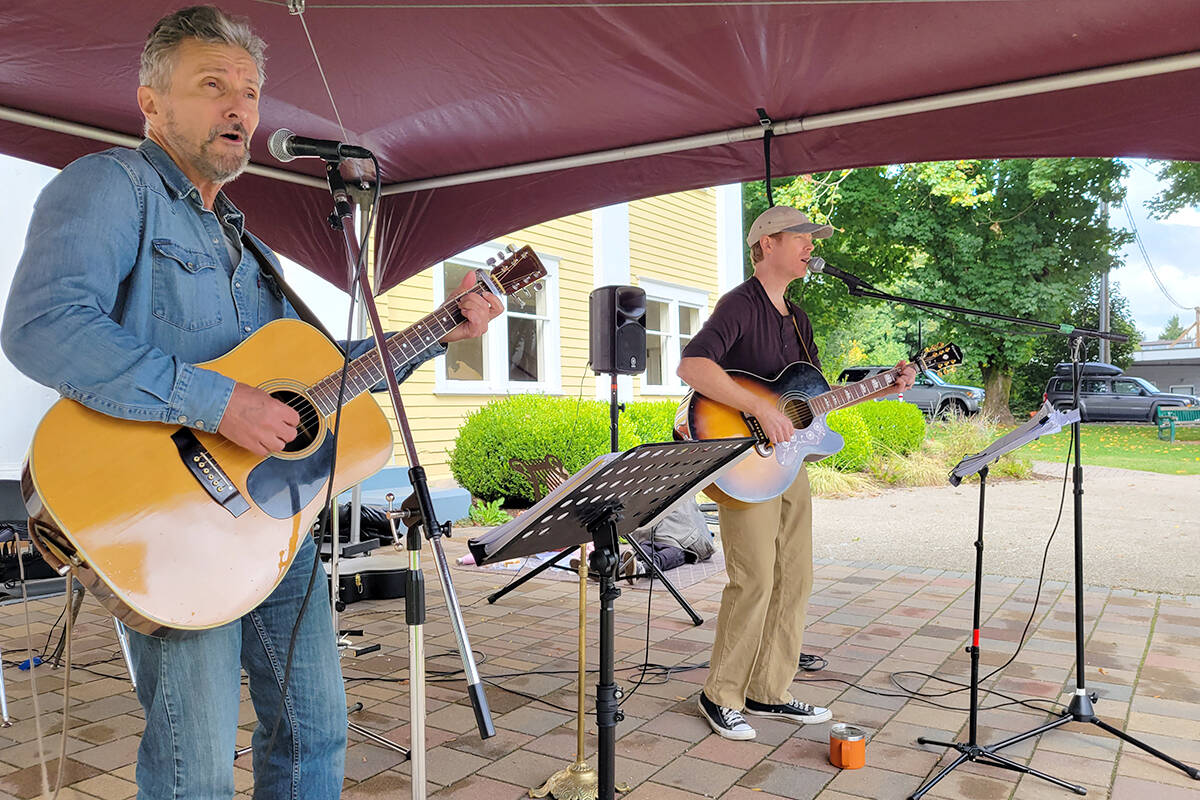 Some of the musicians who took part in the 'Art Crawl at the Hall' event on Sunday, Oct. 3, held on the front lawn of the historic Fort Langley community hall. (Dan Ferguson/Langley Advance Times)