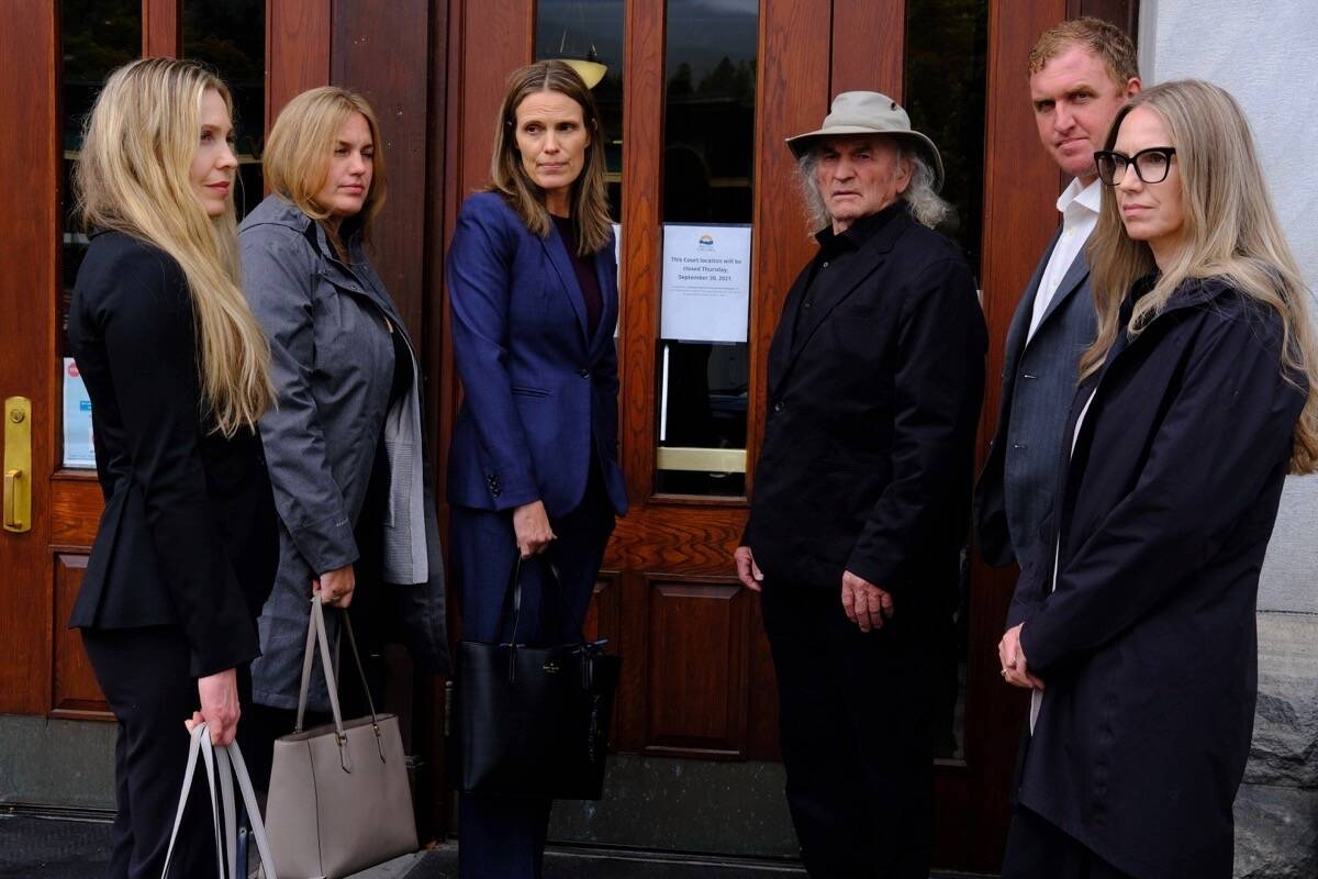 L-R, Peter de Groot's sisters Danna de Groot, Shannon de Groot, and Michelle de Groot, with father Peter de Groot, brother Miles de Groot and sister Kristen de Groot, at the courthouse in Nelson for the inquest into the death Peter de Groot in 2014 near Slocan. Photo: Bill Metcalfe