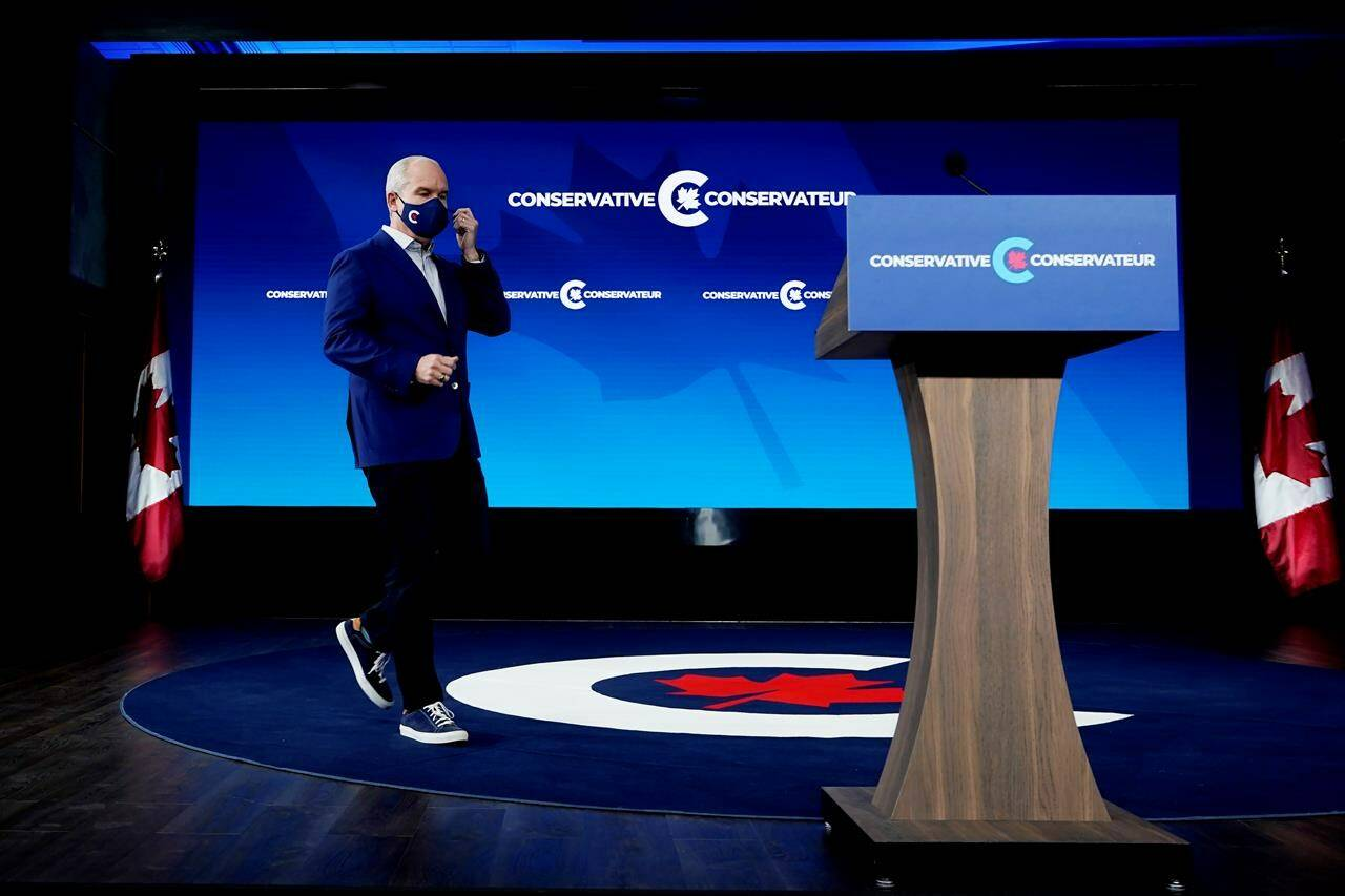 Conservative Leader Erin O'Toole walks on stage as he prepares to speak in Ottawa on Tuesday, September 21, 2021. THE CANADIAN PRESS/Adrian Wyld