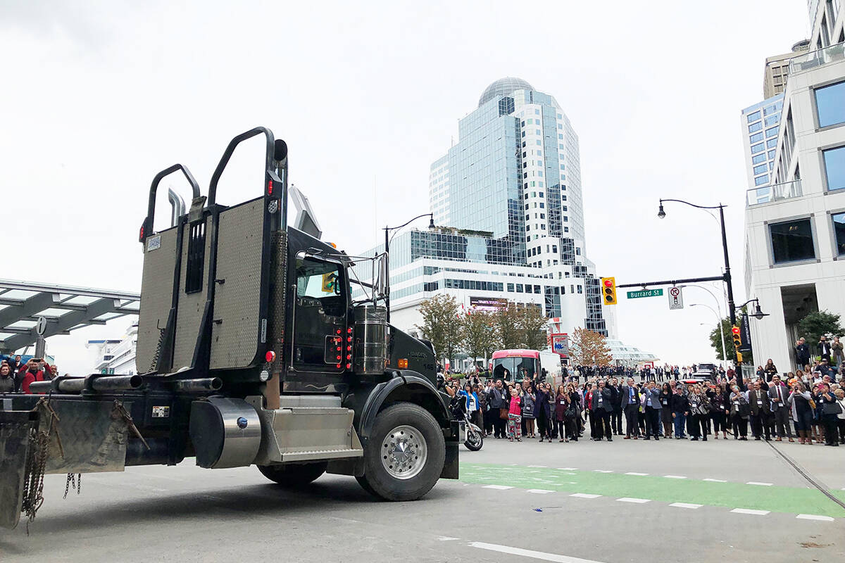 Logging trucks from around the province arrive at the Union of B.C. Municipalities convention in downtown Vancouver to protest forest industry job loss, Sept. 27, 2019. (Kat Slepian/Black Press Media)