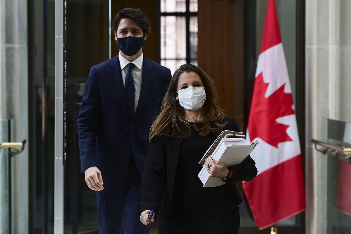 Prime Minister Justin Trudeau and Finance Minister Chrystia Freeland make their way to hold a press conference in Ottawa on Tuesday, April 20, 2021. THE CANADIAN PRESS/Sean Kilpatrick