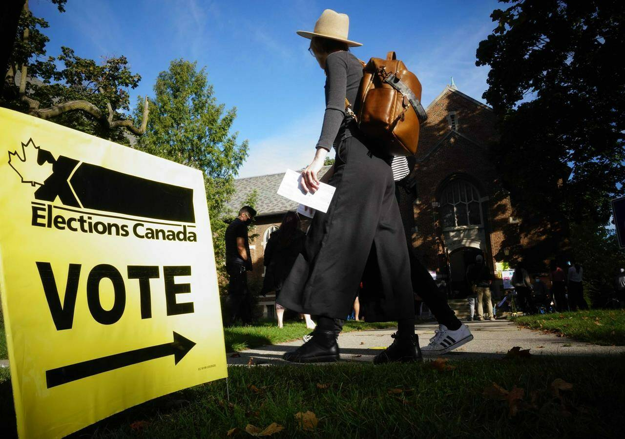 """People start to line up early for the Canadian general election before polls open in west-end Toronto for the Monday, Sept. 20, 2021 election. The NDP has requested an official inquiry into what it calls """"numerous and systemic failures of election officials"""" on election day. THE CANADIAN PRESS/Graeme Roy"""