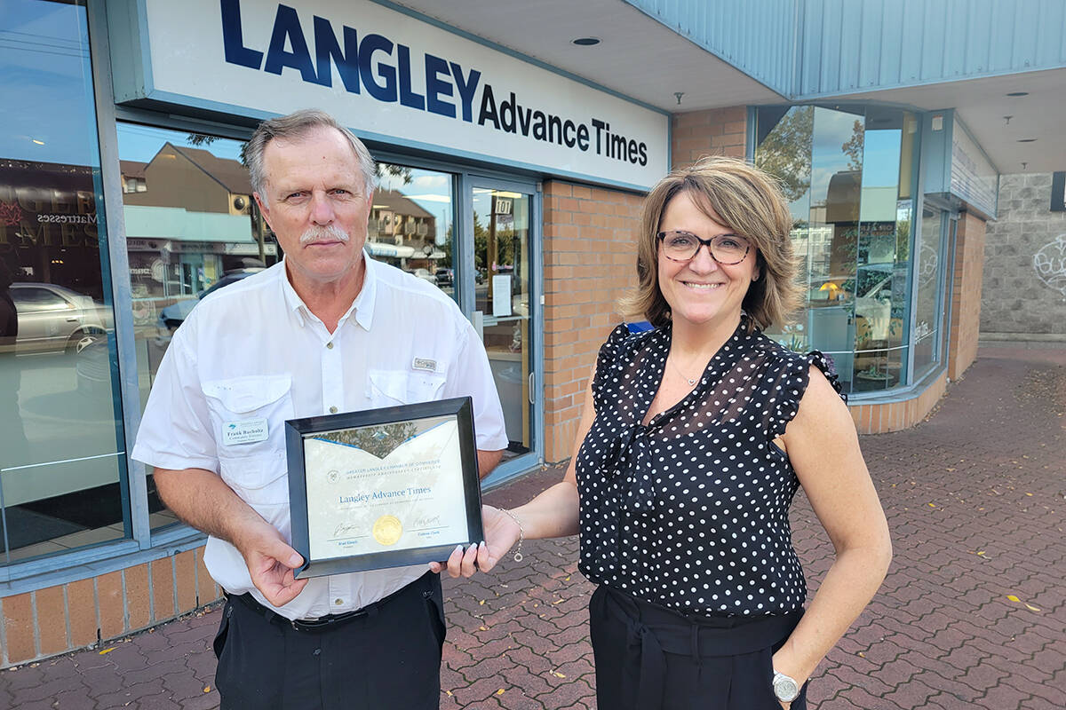 Chamber director and former editor Frank Bucholtz presented a certificate on Monday, Sept. 13, to Langley Advance Times publisher Lisa Farquharson recognizing the long relationship between the association and the paper, one that goes back 90 years. (Dan Ferguson/Langley Advance Times)
