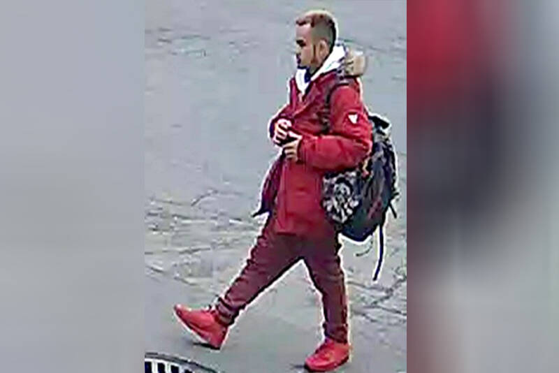 The suspect, seen here on security footage obtained by Vancouver Police is an Asian man in his 20s, with a small build and short, dark hair. He was wearing a red ski jacket, a white hoodie, red pleather pants, and Air Force 1 basketball shoes. He also had a black and red camouflage backpack. (VPD photo)