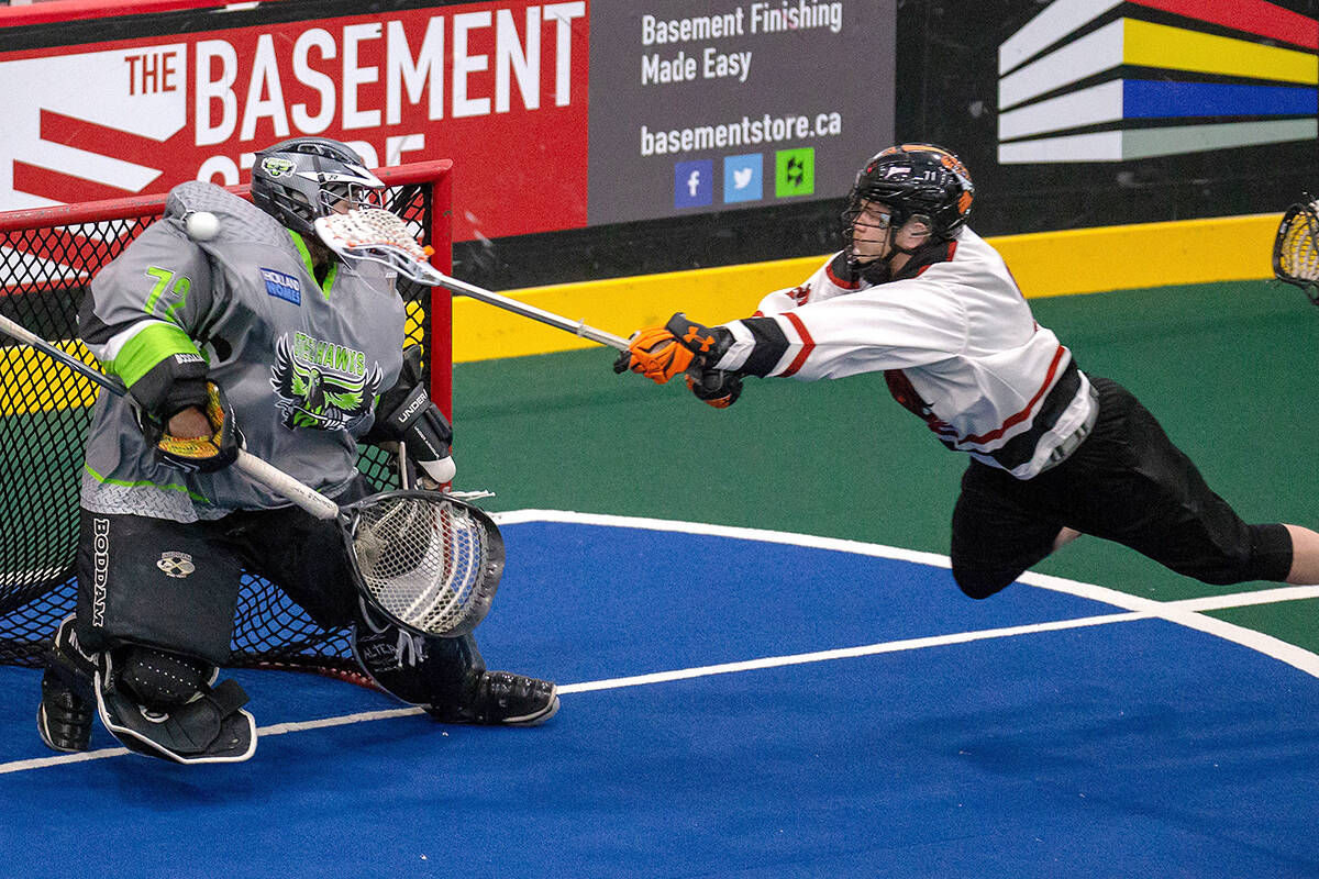Whitby Steelhawks goaltender Lukas Coote gets a shoulder on Toronto Monarchs' Zach Herreweyers diving attempt during ALL action back in 2018. Coote played four seasons in the ALL before signing with the NLL's Georgia Swarm as a free agent while Herreweyers has spent time in the NLL with both Calgary and Halifax. (Tim Prothero Vintage Lax/Special to Langley Advance Times)