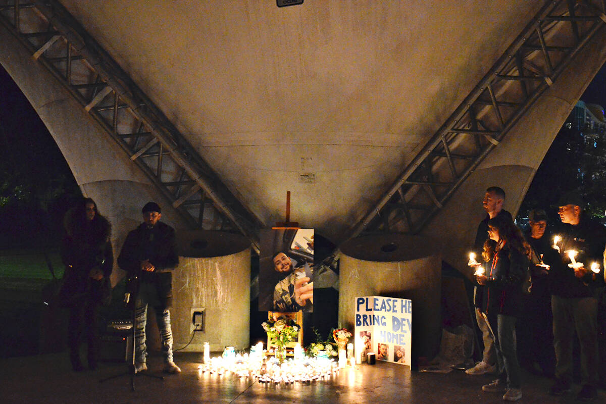 Loved ones shared stories about Devon Goodrick, the subject of a vigil in Douglas Park Thursday evening. (Heather Colpitts/Langley Advance Times)