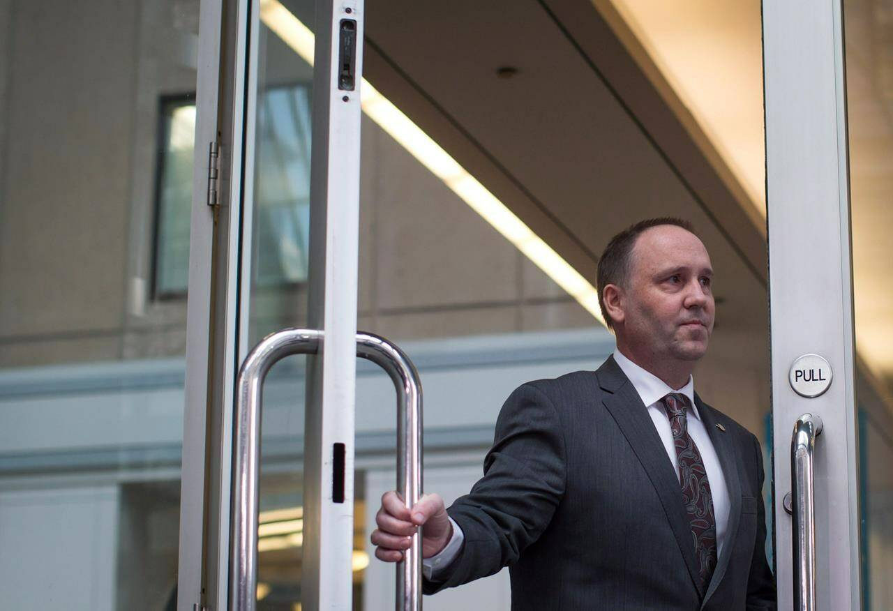 B.C. Liberal MLA Mike Bernier arrives for a news conference in Vancouver on Thursday January 14, 2016. THE CANADIAN PRESS/Darryl Dyck