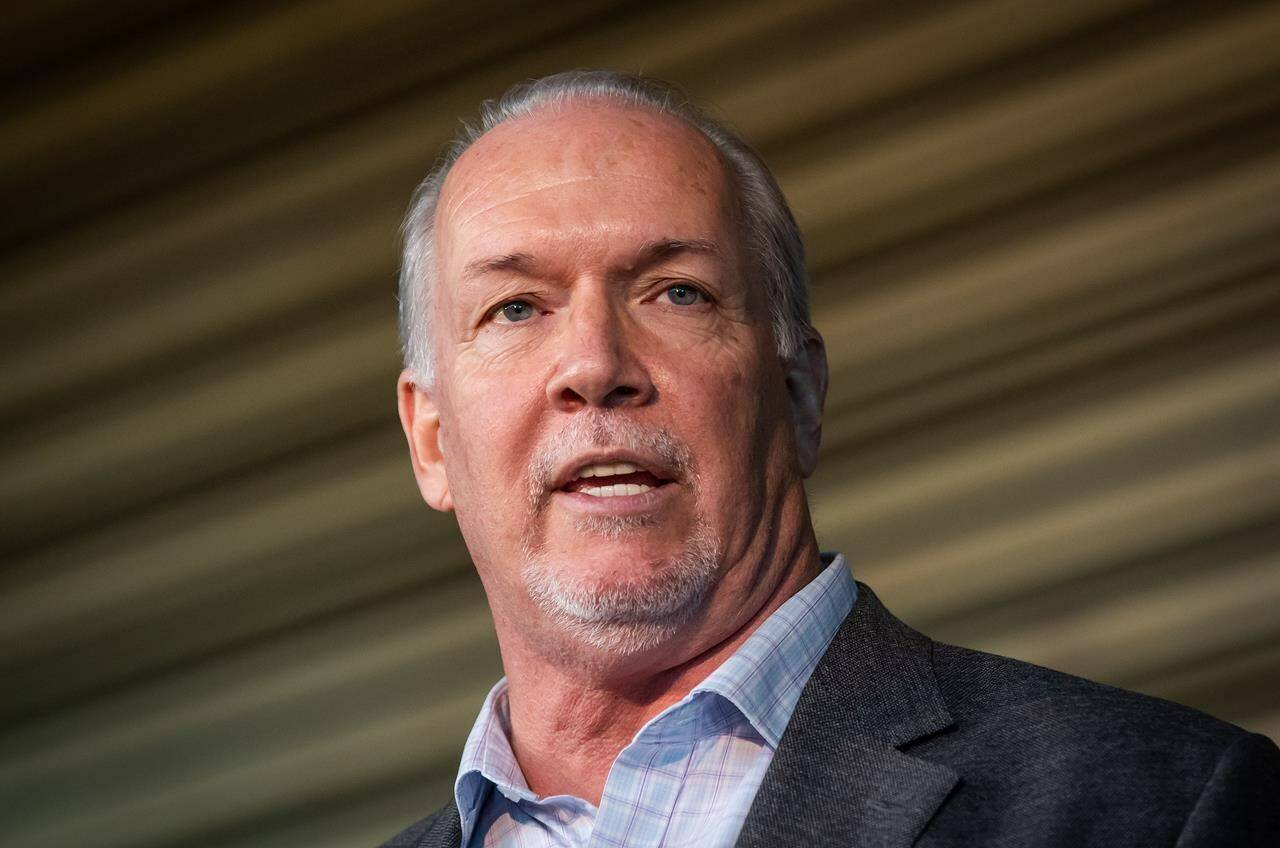 B.C. Premier John Horgan speaks after the B.C. Lions CFL football team announced they would recognize the first National Day for Truth and Reconciliation in Vancouver on Thursday, September 16, 2021. THE CANADIAN PRESS/Darryl Dyck