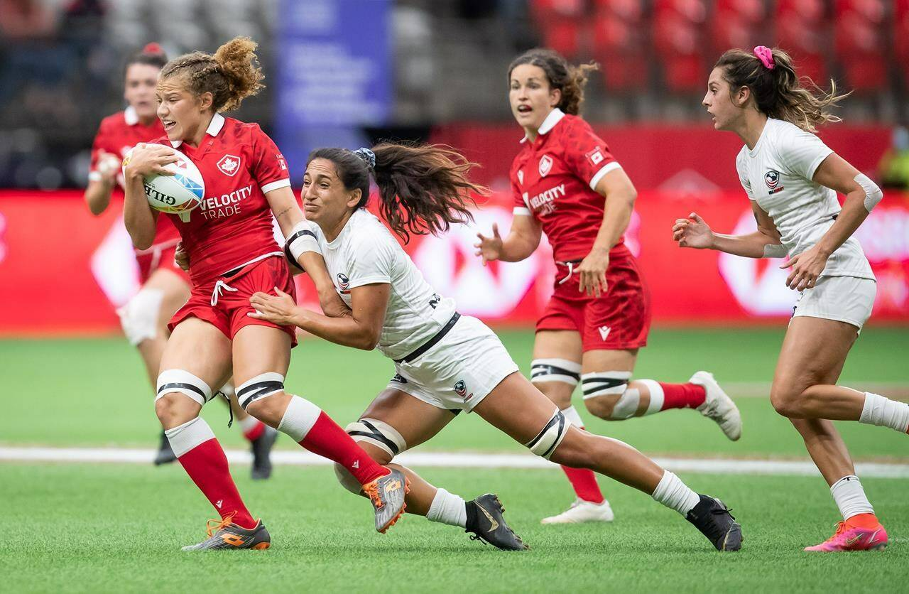 Canada's Renee Gonzalez, left, is tackled by United States' Sarah Levy during HSBC Canada Sevens women's semifinal rugby action, in Vancouver, on Sunday, September 19, 2021. THE CANADIAN PRESS/Darryl Dyck