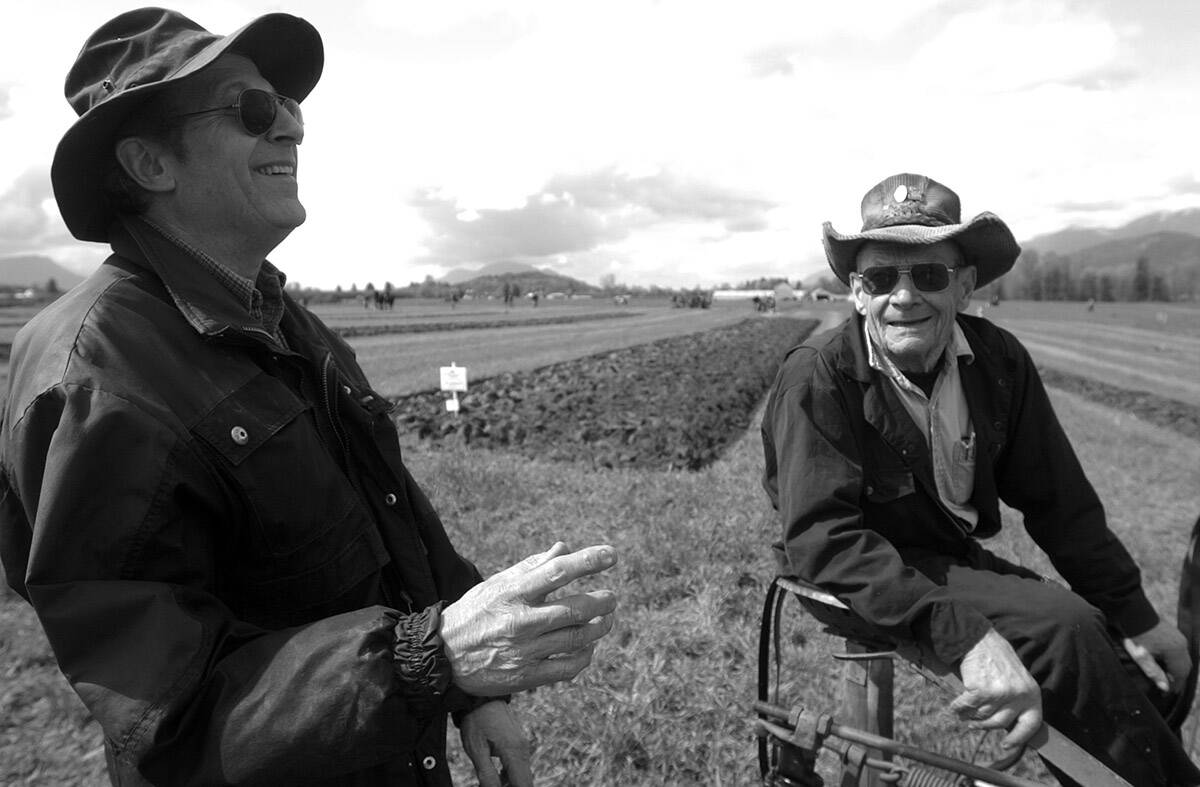 François Freyvogel (left) shares a laugh with Ted Giesbrecht during the Chilliwack Plowing Match on April 9, 2005. Tuesday, Oct. 12, 2021 is Old Farmers' Day. (Jenna Hauck/ Chilliwack Progress file)