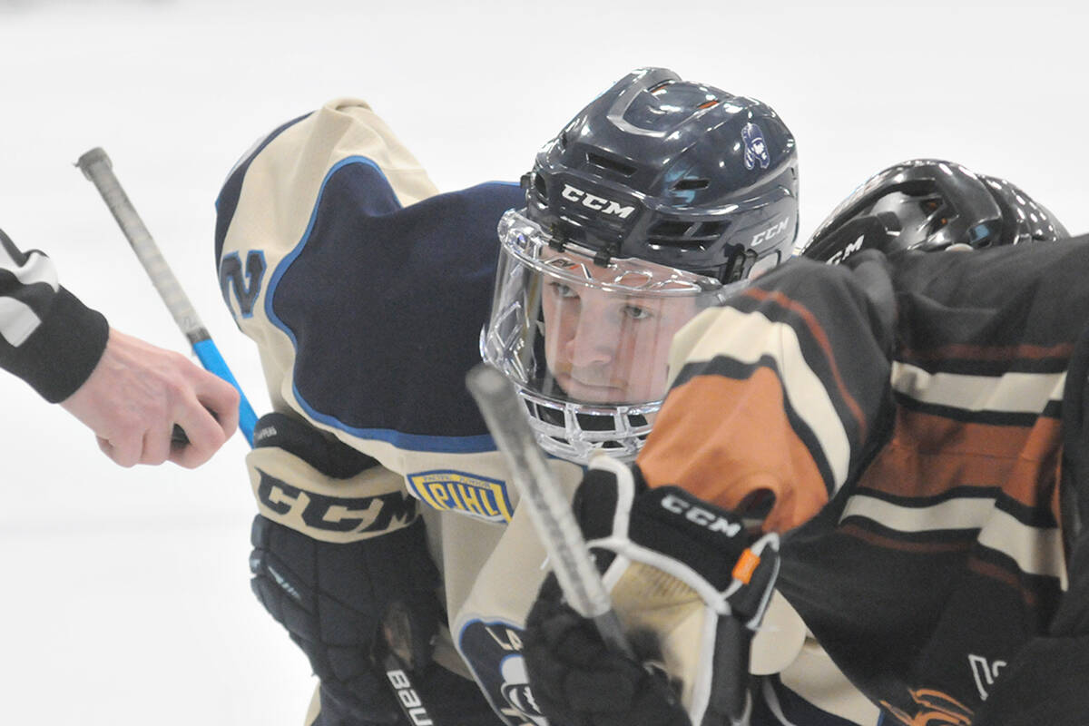 Trappers' Brendan O'Grady faces off in the first period of the Oct. 6 game at George Preston that would see rival Kodiaks win 3-1. (Dan Ferguson/Langley Advance Times)