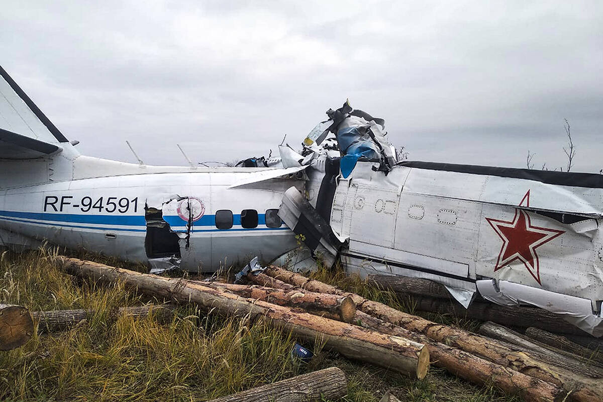 This photo provided by the Russian Emergency Situations Ministry press service shows the L-410, a Czech-made twin-engine turboprop, crashed near the town of Menzelinsk, about 960 kilometers (600 miles) east of Moscow, Russia, Sunday, Oct. 10, 2021. A plane carrying skydivers crashed Sunday shortly after takeoff in central Russia, reportedly killing 15 of the 22 people aboard. The L-410, a Czech-made twin-engine turboprop, crashed near Menzelinsk, about 960 kilometers (600 miles) east of Moscow (Ministry of Emergency Situations press service via AP)