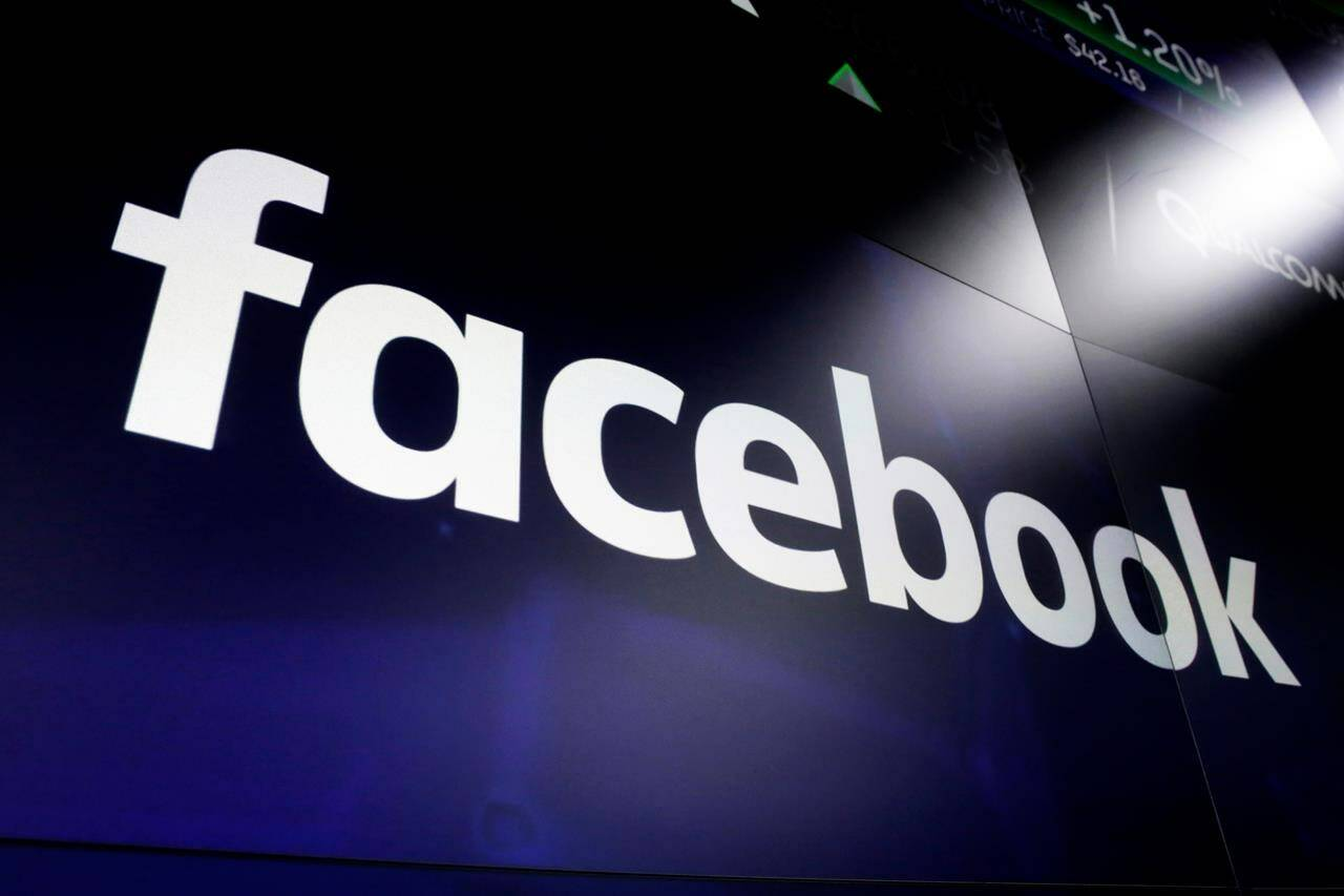 FILE - In this March 29, 2018, file photo is the Facebook logo on screens at the Nasdaq MarketSite, in New York's Times Square. (AP Photo/Richard Drew, File)