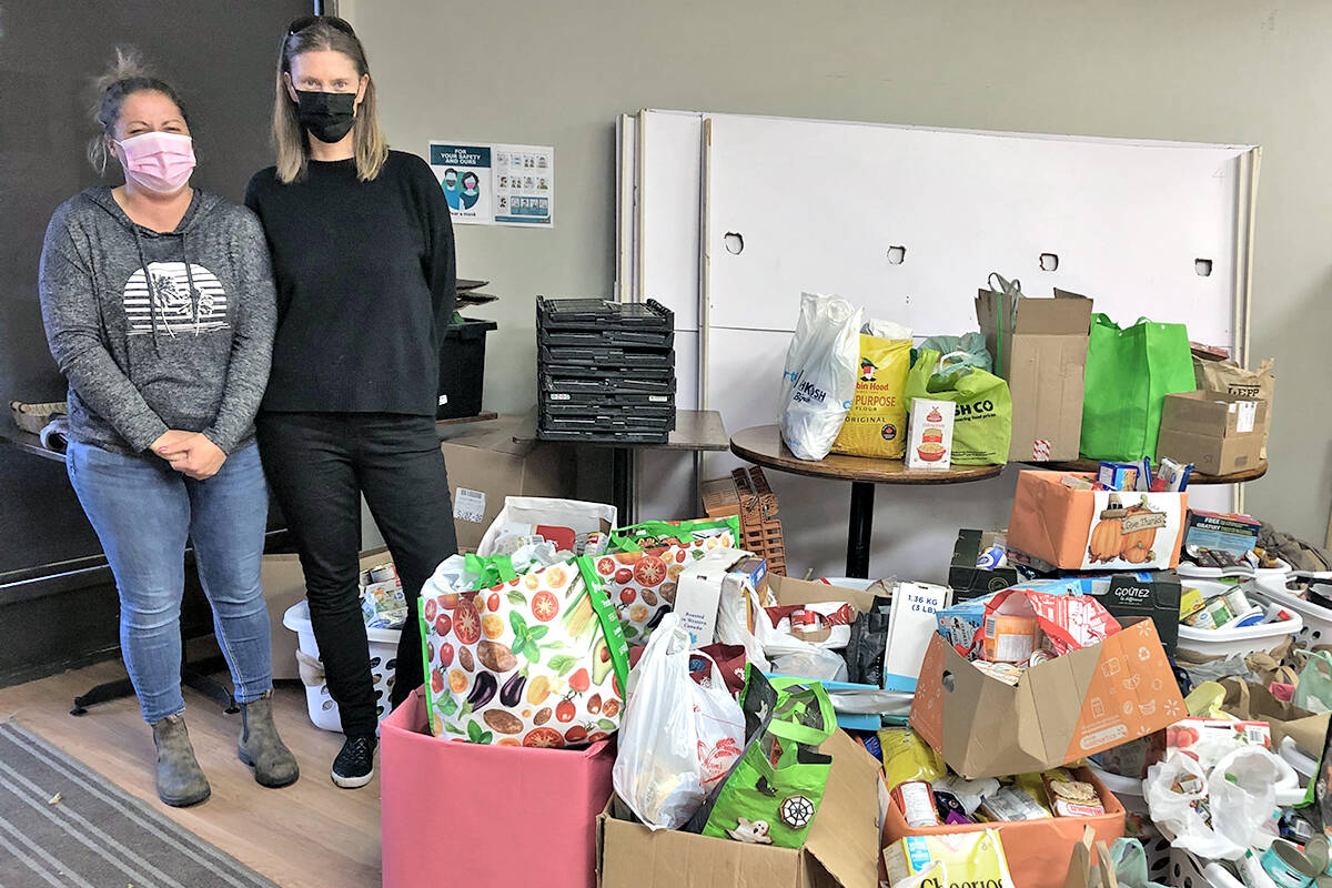 Karyn Smith, PAC past president (left) and Laila Meyer, PAC treasurer with a room full of food items collected by students at Coghlan Elementary School. Aldergrove Food bank took delivery on Oct. 5. (Special to Langley Advance Times)