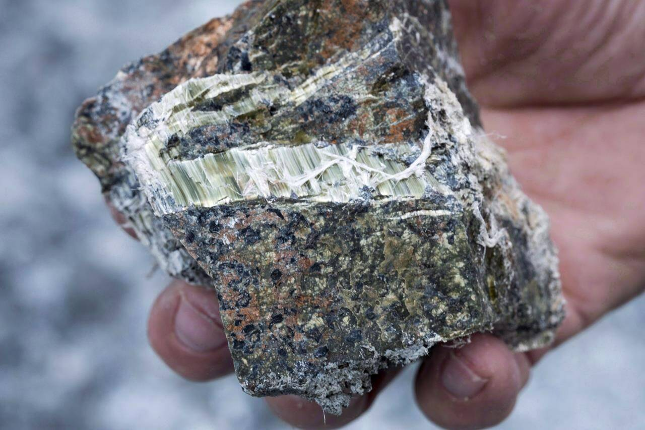 A chunk of asbestos is displayed in Asbestos, Que., in an August 10, 2016, file photo. A group of doctors and environment advocates say the Liberals need to close a loophole that is allowing the resale of second-hand products containing asbestos. THE CANADIAN PRESS/Paul Chiasson