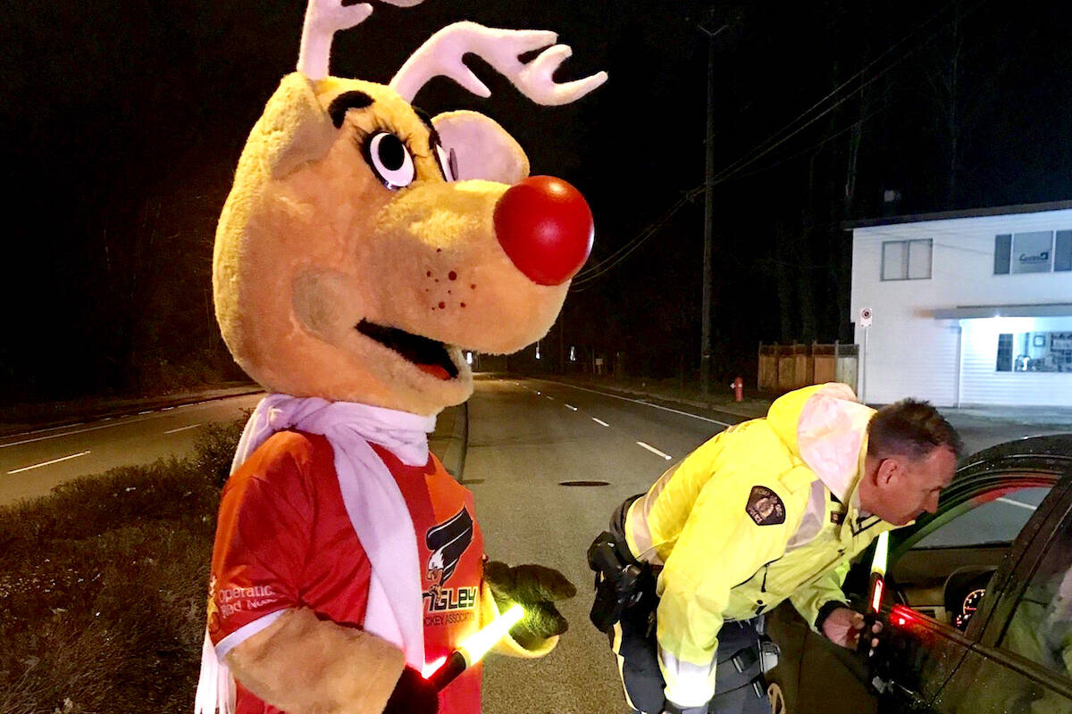 Rudy helped out at an RCMP check stop in 2019 in Langley to promote Operation Red Nose. (Michelle Cowan/Special to the Langley Advance Times)