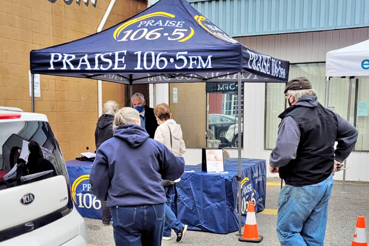 """Praise 106.5 FM from Lynden sent the new host of the station's """"A New Day"""" Show, Greg Otterholt, to broadcast live from the front parking lot of the food bank at 5768 203rd St. on Saturday, Oct. 9. (Special to Langley Advance Times)"""