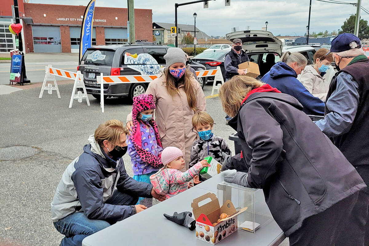 A live radio broadcast from the Langley Food Bank raised more than $400 in cash and filled seven bins with donated food on Saturday, Oct. 9. (Special to Langley Advance Times)