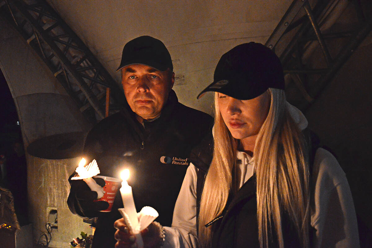 Nick Goodrick and his daughter, Nikki, at a candlelight vigil held for Devon Goodrick at Douglas Park in Langley City on Oct. 7, 2021. (Langley Advance Times file)