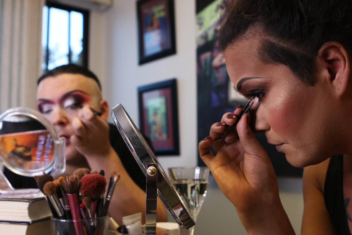 Kelowna drag queens Ella Lamoureux, right, and Jenna Telz prepare before a show at the Friends of Dorothy Lounge on Oct. 1. (Aaron Hemens/Capital News)