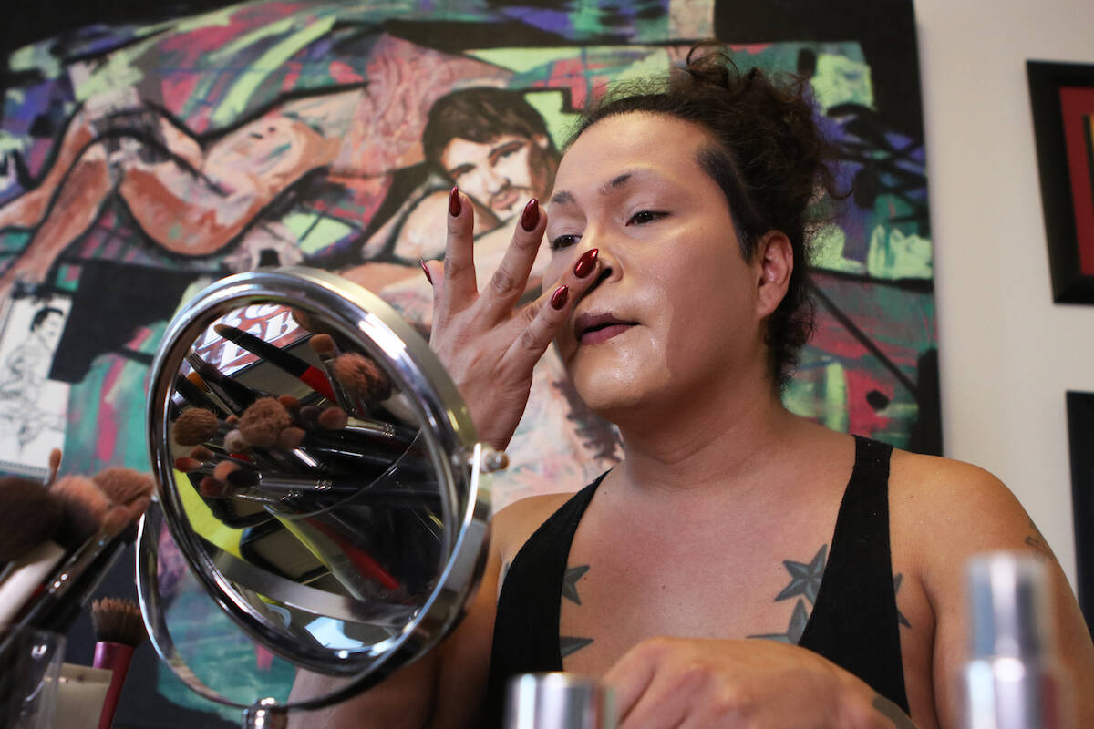 Kelowna drag queen Ella Lamoureux prepares her makeup before a show at the Friends of Dorothy Lounge on Oct. 1. (Aaron Hemens - Capital News)