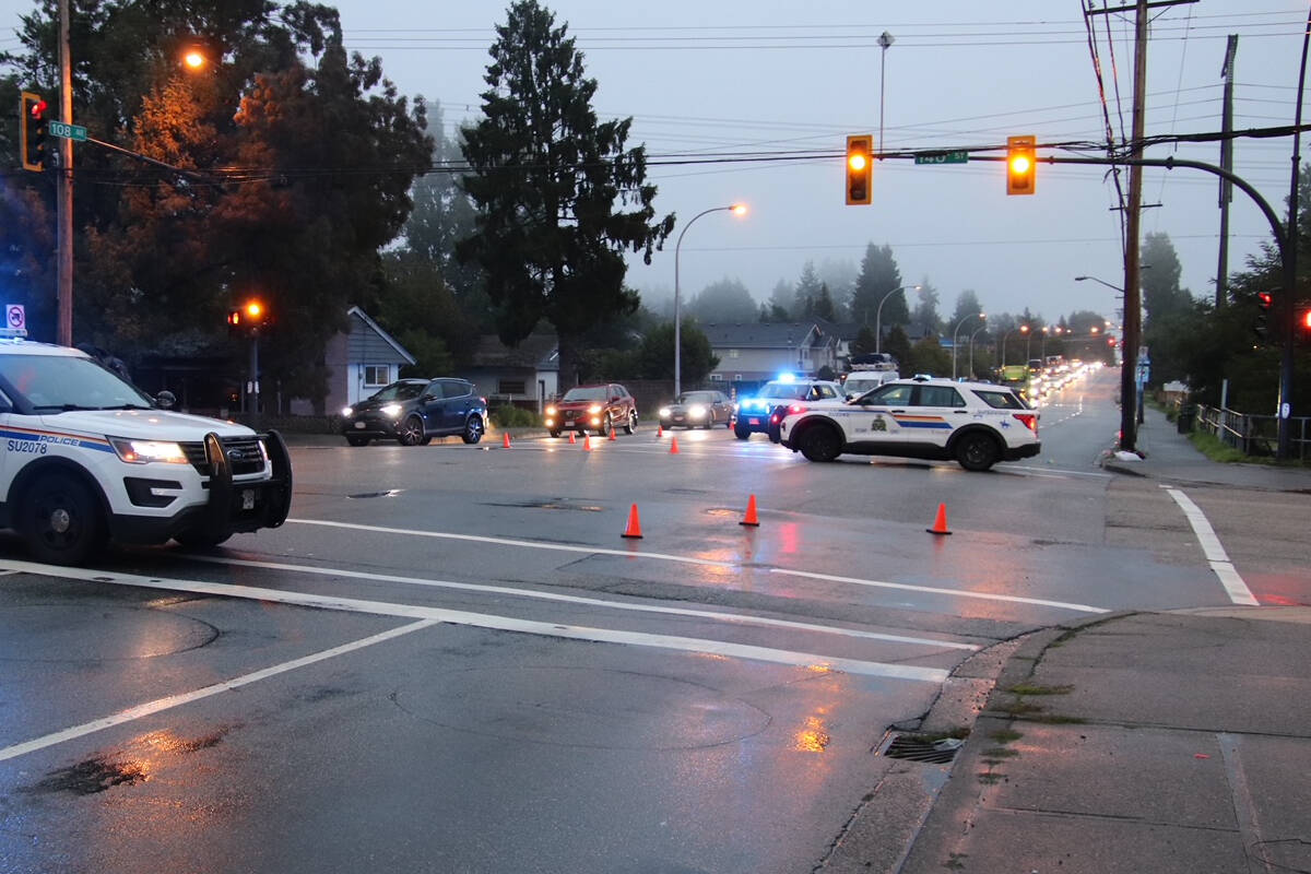 Surrey RCMP say the intersection of 108 Avenue and 140 Street is closed in all directions following a crash involving a pedestrian on Thursday (Oct. 14, 2021). (Photo: Shane MacKichan)