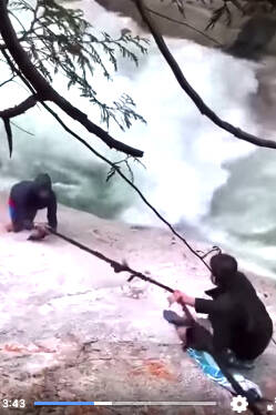 Person being pulled to safety. (Screen grab)