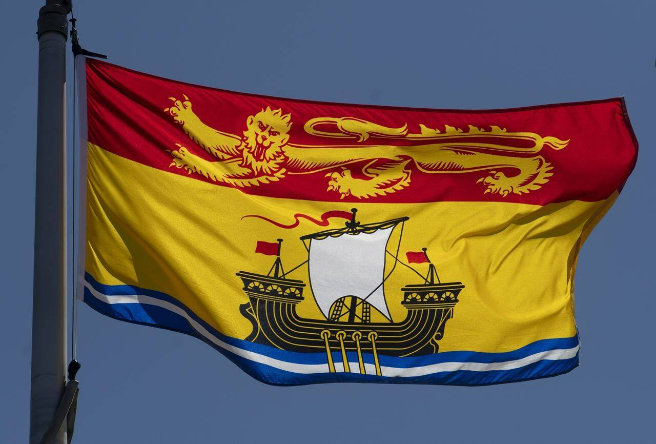 New Brunswick's provincial flag flies in Ottawa, Monday, July 6, 2020. Government employees in New Brunswick have been ordered to stop making territorial or title acknowledgements in reference to First Nations lands. THE CANADIAN PRESS/Adrian Wyld