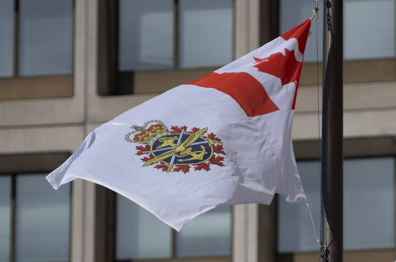 """The Canadian Forces flag flies outside office buildings in Ottawa, Tuesday March 9, 2021. Military police say they are investigating """"historic"""" allegations of sexual misconduct involving yet another senior commander, this time the officer responsible for human resources in the Canadian Armed Forces. THE CANADIAN PRESS/Adrian Wyld"""