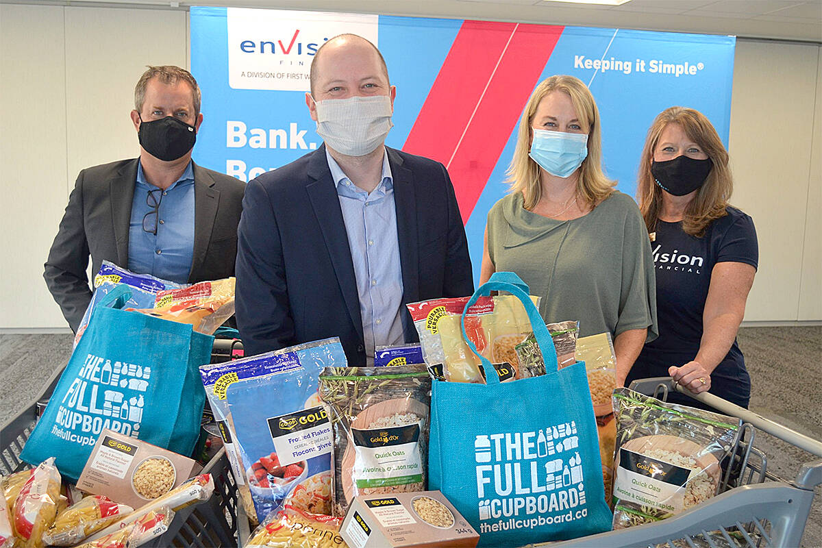 Dave Lanphear, (left) Envision Financial president; Dan Huang-Taylor, executive director of Food Banks BC; Launi Skinner, CEO of First West Credit Union; and Susan Byrom, executive director of the First West Foundation share news of the Full Cupboard milestone. (Special to Black Press Media)