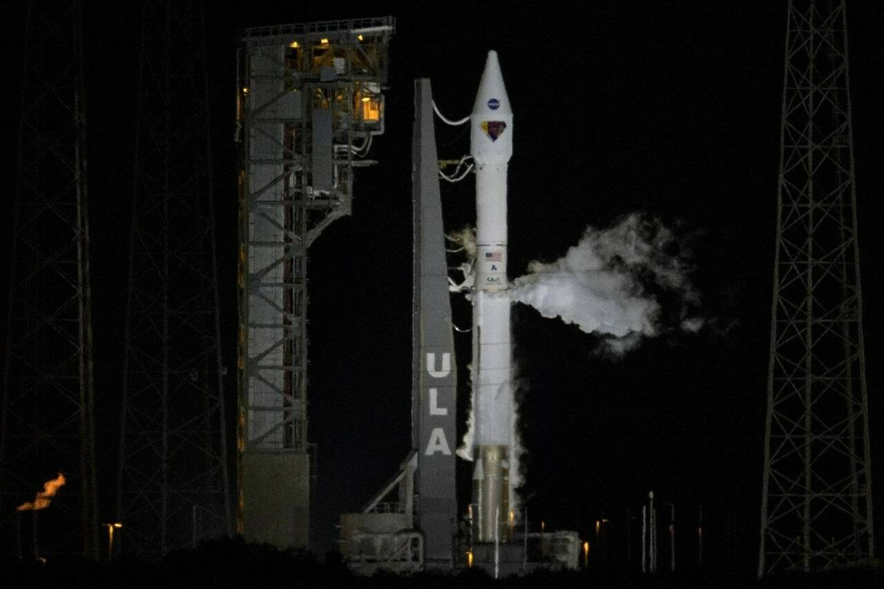 """In this photo released by NASA, a United Launch Alliance Atlas V rocket with the Lucy spacecraft stands ready to launch from Space Launch Complex 41, Saturday, Oct. 16, 2021, at Cape Canaveral Space Force Station in Florida. Lucy will be the first spacecraft to study Jupiter's Trojan Asteroids. Like the mission's namesake – the fossilized human ancestor, """"Lucy,"""" whose skeleton provided unique insight into humanity's evolution – Lucy will revolutionize our knowledge of planetary origins and the formation of the solar system. (Bill Ingalls/NASA via AP)"""