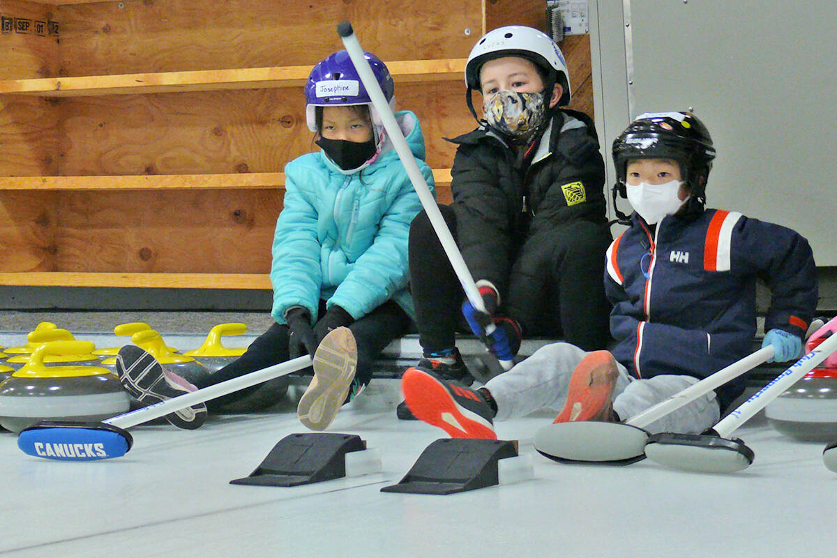 A Canadian Tire Jumpstart grant has purchased new light-weight, but full-size, curling stones for the Langley Curling centre 'Little Rock' program for kids, seen here practicing on Saturday, Oct. 16. (Dan Ferguson/Langley Advance Times)